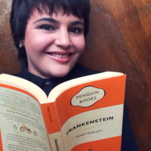 Image of Sheree Strange reading a book (Frankenstein, Penguin Books triband edition)